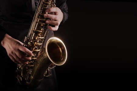 Saxophone player Saxophonist playing Jazz music instruments close up musicians hands