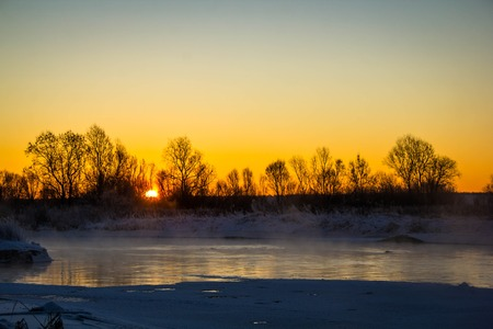 Frosty morning during dawn on the river Usva, Russia.