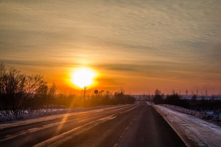 sunset and road. road outside the city. Russian roads in the outback