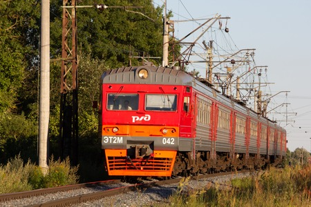 The train is on the rails in the evening. Russian railway. Electric train Russia, Leningrad region, Gatchina, August 8, 2018
