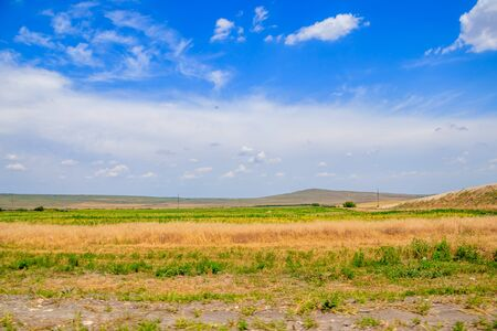 Russian open spaces. Crimea. Field. Summer Russian landscapes. Road views. Grass and sky. Background summer landscape. Crimean fields