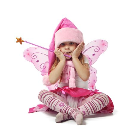 Portrait of sweet little girl in Christmas fairy costume