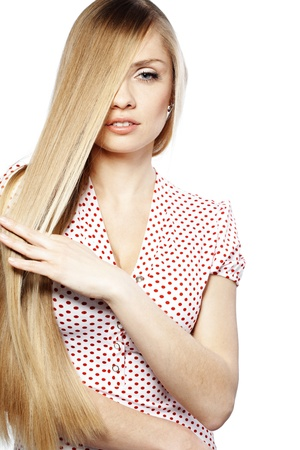 Portrait of young beautiful woman with long glossy blond hair