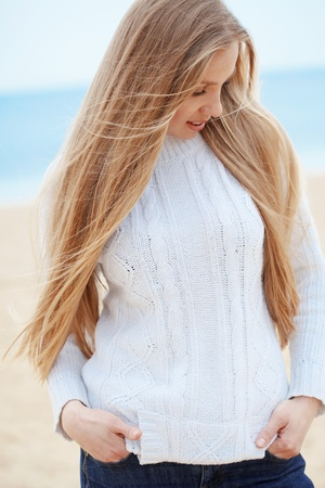 Beautiful young woman resting at the beach