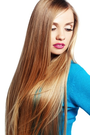 Portrait of young beautiful woman with long strong blond hair