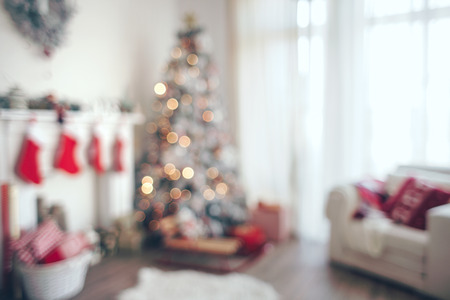 Beautiful holdiay decorated room with Christmas tree, out of focus shot for photo background