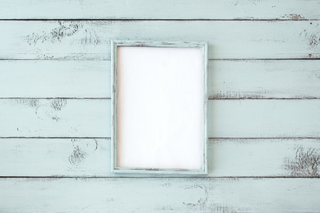 Photo for Wooden photo frame on mint shabby chic background - Royalty Free Image
