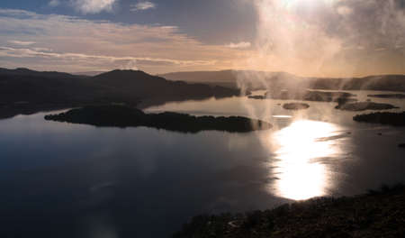 Sunrise  Little cloud suddenly lifted up from lake Loch Lomond in Scotland
