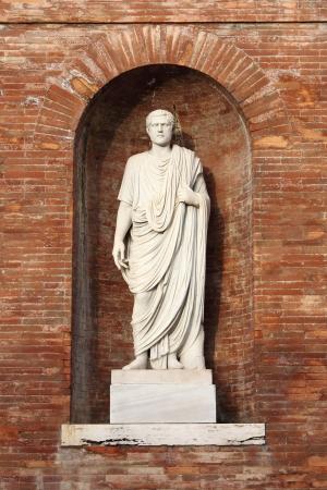 Statue of a roman Senator located in Quirinale Square. Rome, Italy