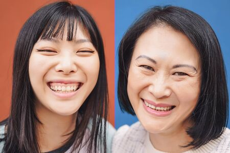 Foto de Happy Asian mother and daughter having fun outdoor - Portrait Chinese family people spending time together outside - Love, relationship and parenthood lifestyle concept - Imagen libre de derechos