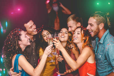 Photo for Happy friends celebrating new year eve holidays in disco club - Young people doing private party with deejay and drinking champagne - Youth culture entertainment lifestyle concept - Royalty Free Image