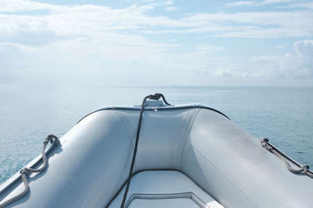 Photo pour Front view grey Inflatable rubber boat floating on the sea with seascape horizon in a sunny day - body copy - image libre de droit