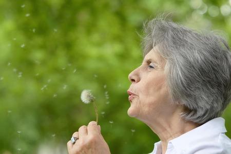 Foto für Portrait of an elderly woman on a walk in the park in late spring - Lizenzfreies Bild