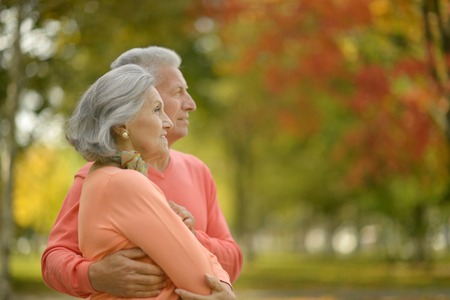 Photo for Beautiful caucasian elderly couple in the park in autumn - Royalty Free Image