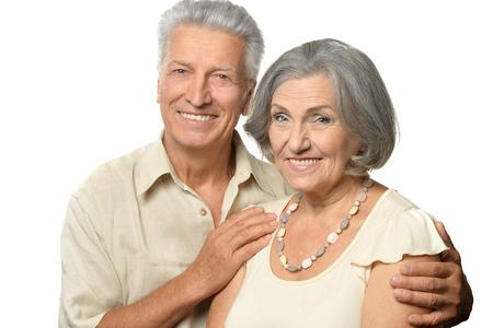 Photo pour Portrait of a happy senior couple at white background - image libre de droit