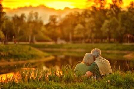 Photo pour Loving mature couple  in summer park on the Sunset - image libre de droit