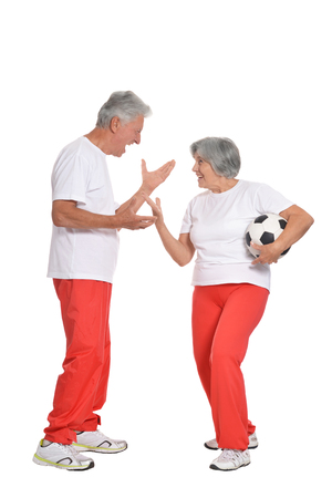 mature couple are going to play football
