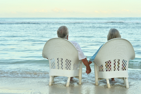 Portrait of a senior couple resting on beachの写真素材