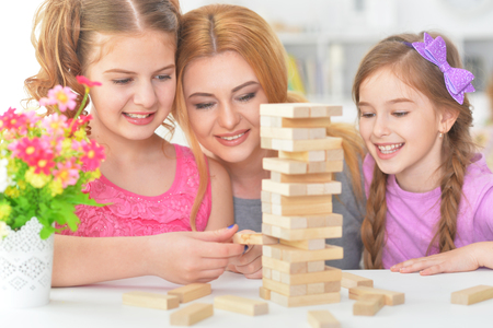 Family playing with  blocks together
