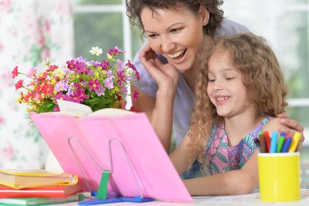 woman and girl doing homework