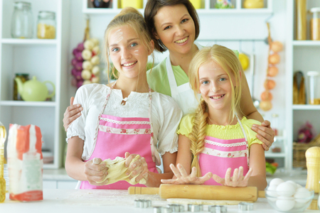 sisters and mom in the kitchen
