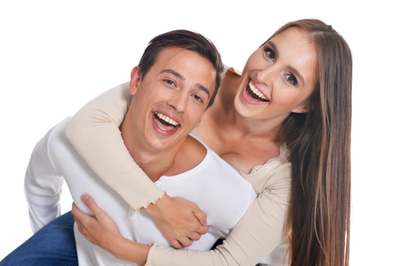 Photo for Portrait of happy young couple embracing on white background - Royalty Free Image