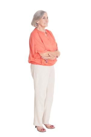 Photo pour Portrait of smiling senior woman posing isolated on white background - image libre de droit