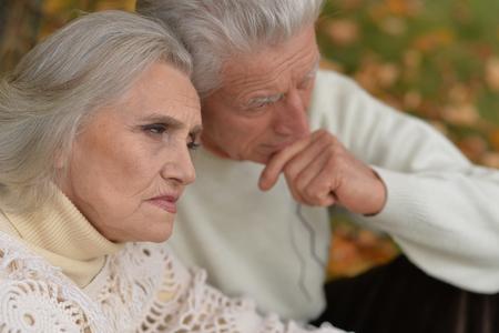 Photo for Close up portrait of sad senior couple in autumn park - Royalty Free Image