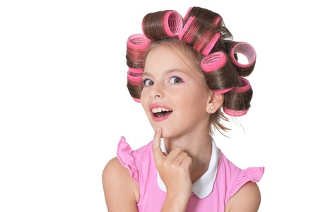 Photo pour Portrait of emotional little pretty girl with hair curlers posing isolated - image libre de droit