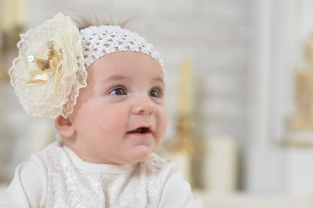 Photo pour Close-up portrait of cute adorable baby girl - image libre de droit