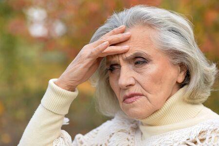 Photo pour Close up portrait of sad woman posing outdoors - image libre de droit