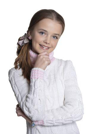 Photo pour Portrait of smiling little girl wearing warm sweater on white background - image libre de droit