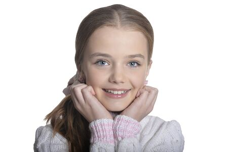 Photo pour Portrait of smiling little girl wearing warm sweater on white background - image libre de droit