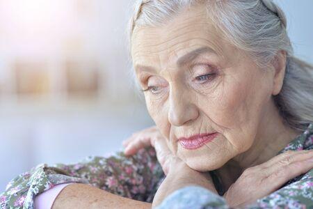 Photo pour Close up portrait of sad senior woman - image libre de droit