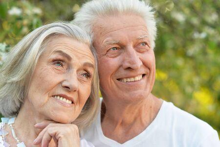 Photo pour Portrait of senior couple posing in the park - image libre de droit