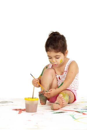 Photo pour Portrait of lovely young girl draws painting while sitting on the floor - image libre de droit