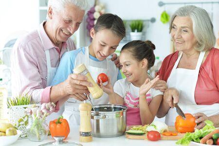 Photo pour Portrait of family cooking together in kitchen - image libre de droit