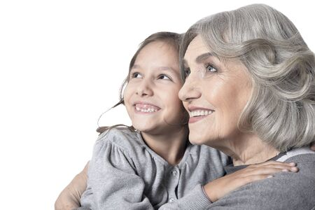 Photo pour Happy grandmother and granddaughter looking at the distance isolated on white background - image libre de droit