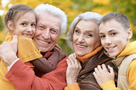 Photo pour Happy grandfather, grandmother and grandchildren in park - image libre de droit