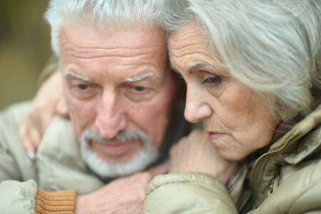 Photo pour Portrait of sad thoughtful senior couple in park - image libre de droit