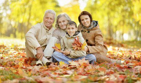 Foto für Cute happy family relaxing in autumn forest - Lizenzfreies Bild