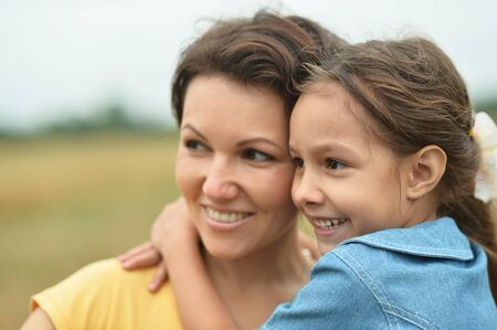 Photo pour Happy mother and daughter at summer field - image libre de droit