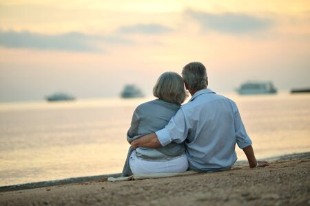 Photo for Portrait of mature couple relaxing on beach - Royalty Free Image