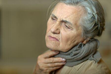 Photo pour Close up portrait of sad ill senior woman - image libre de droit