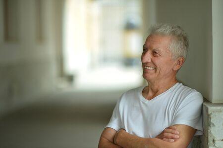 Photo pour Portrait of happy senior man at home - image libre de droit