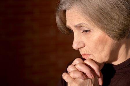 Photo pour Portrait of sad senior woman at home - image libre de droit