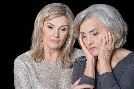 Photo pour Portrait of a two sad women posing - image libre de droit
