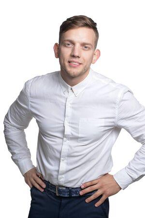 Photo pour Portrait of handsome smiling young man wearing white shirt - image libre de droit