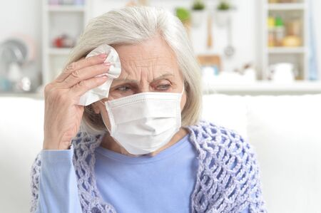 Photo for Ill beautiful senior woman with facial mask - Royalty Free Image