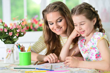 Photo for Portrait of girl with mother drawing at home - Royalty Free Image